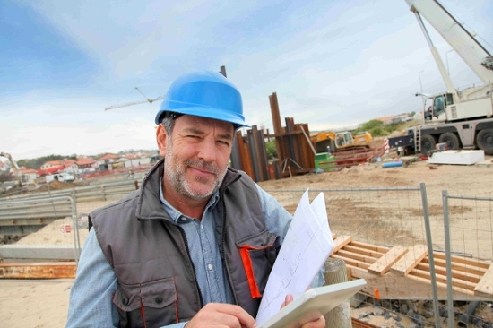 Contractor reviewing his tax documents and payroll